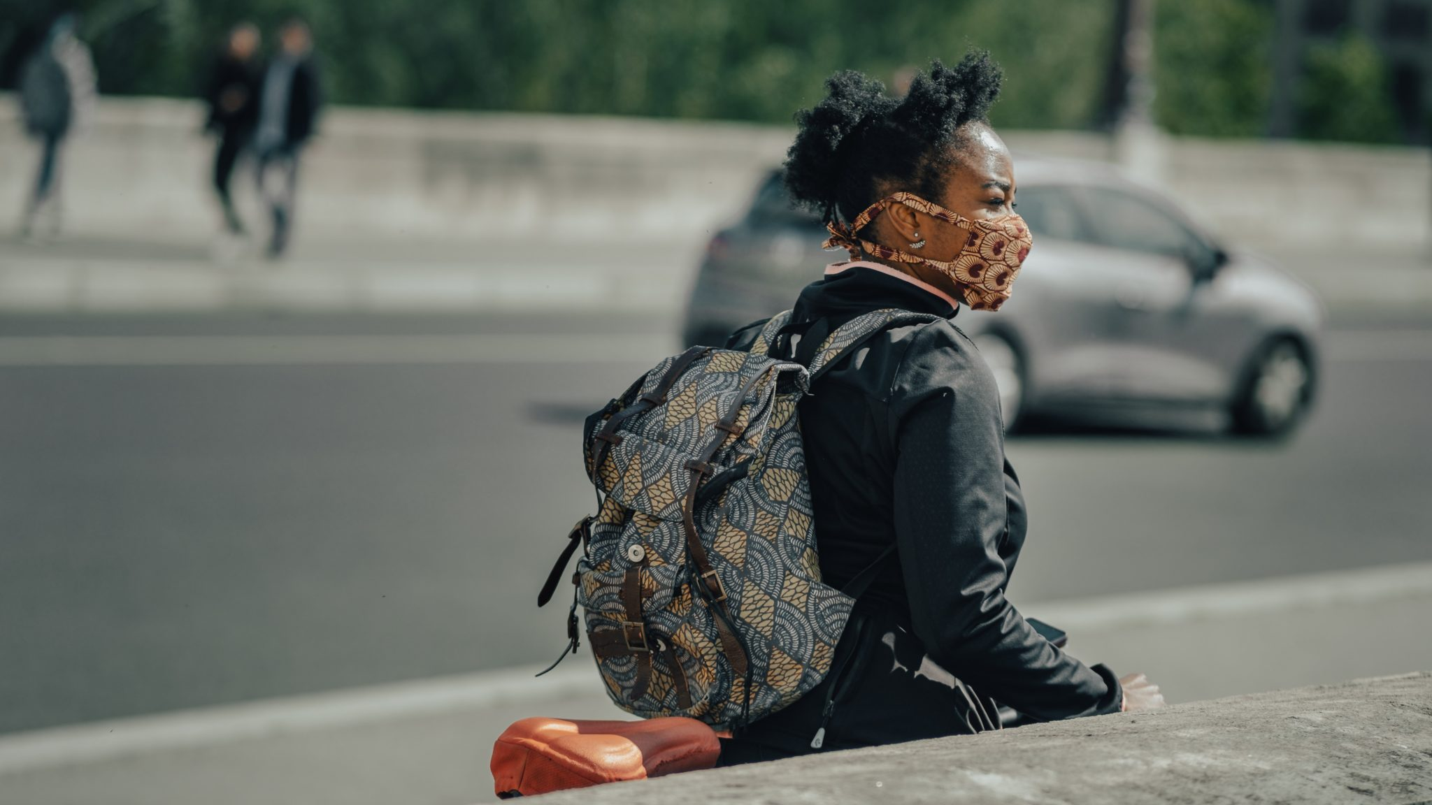 African american woman wearing a mask in the street