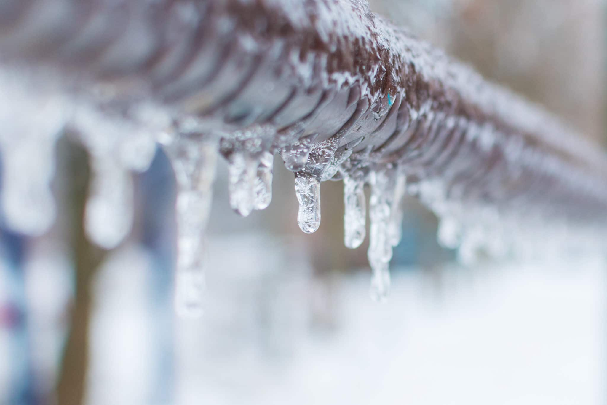 Frozen,Icicles,After,Rain,On,The,Pipe